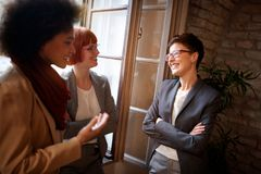 Smiling business woman having casual meeting Royalty Free Stock Image