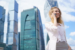 Smiling business woman having pleasant conversation on mobile phone Royalty Free Stock Images