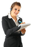 Smiling business woman with headset and clipboard Royalty Free Stock Photos