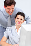 Smiling business woman and her colleague working Stock Image
