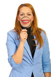 Smiling business woman hold loupe Stock Photos