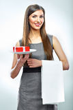 Smiling business woman hold red gift on a plate. Royalty Free Stock Photography