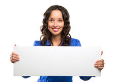 Smiling business woman hold white advertising board. White card. Stock Images