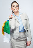 Smiling Business woman hold white shopping bag. Royalty Free Stock Images