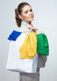 Smiling Business woman hold white shopping bag. Royalty Free Stock Photos