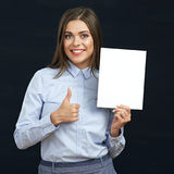 Smiling business woman holding advertising board. Stock Photos