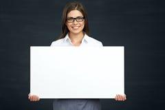 Smiling business woman holding advertising board. Eyeglasses wearing girl Stock Image