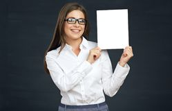 Smiling business woman holding advertising board. Eyeglasses wearing girl Royalty Free Stock Image