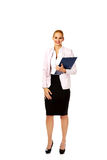 Smiling business woman holding a binder Royalty Free Stock Photo