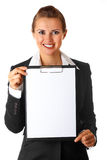 Smiling business woman holding blank clipboard Stock Photo