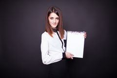 Smiling business woman holding blank clipboard Royalty Free Stock Photos