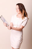 Smiling business woman holding blank clipboard Stock Image