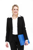 Smiling business woman holding blue folder Royalty Free Stock Image