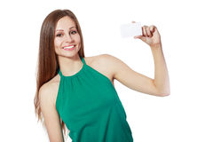 Smiling business woman holding card Royalty Free Stock Image