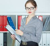 Smiling business woman holding document on clipboard. Stock Images