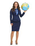 Smiling business woman holding earth globe Stock Photos
