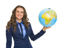 Smiling business woman holding earth globe Stock Image