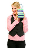 Smiling business woman holding gift bag Royalty Free Stock Photography