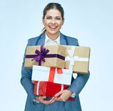 Smiling business woman holding gift box. Royalty Free Stock Photography