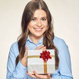 Smiling business woman holding gift box. Isolated studio portrait Stock Photography