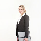 Smiling business woman holding gray bag Royalty Free Stock Photo