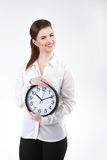 Smiling Business woman holding in hands clock, isolated on white. Background Royalty Free Stock Images