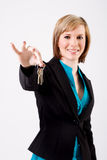 Smiling business woman holding keys. Which are in focus Stock Photography