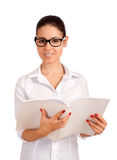 Smiling business woman holding magazine Royalty Free Stock Photos