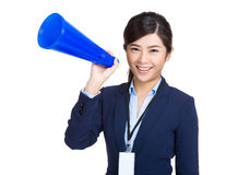 Smiling business woman holding megaphone Stock Photo