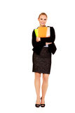 Smiling business woman holding notebooks Stock Photography