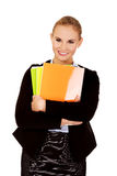 Smiling business woman holding notebooks Stock Image