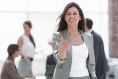 Smiling business woman holding out her hand for a handshake stock photo