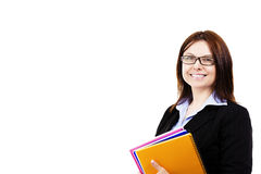 Smiling business woman holding pads of notepaper Royalty Free Stock Photography