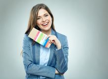 Smiling business woman holding passport with ticket. Isolated portrait Stock Photography