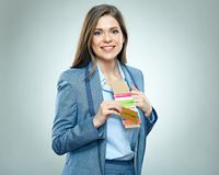Smiling business woman holding passport with ticket. Isolated portrait Royalty Free Stock Photos