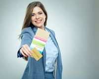 Smiling business woman holding passport with ticket. Isolated portrait Royalty Free Stock Photo