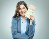 Smiling business woman holding passport with ticket. Isolated portrait Royalty Free Stock Images