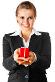 Smiling business woman holding present in hands Royalty Free Stock Photo