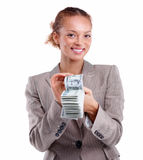 Smiling business woman holding stack of cash Stock Photo