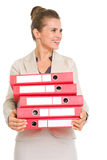 Smiling business woman holding stack of folders Royalty Free Stock Photography