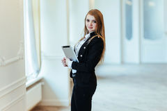 Smiling business woman holding a tablet computer at the office Royalty Free Stock Photography