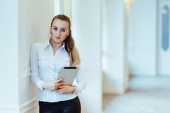 Smiling business woman holding a tablet computer at the office Stock Photos