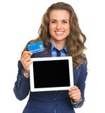 Smiling business woman holding tablet pc and credit card Stock Image