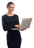 Smiling business woman holding and working on laptop Stock Photography