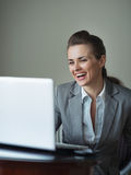 Smiling business woman in hotel room Stock Photo