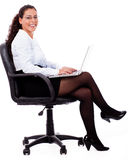 Smiling business woman with laptop Stock Images