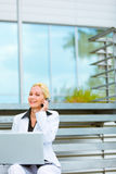 Smiling business woman with laptop at office Royalty Free Stock Photo