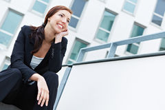 Smiling business woman looking Stock Image