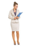 Smiling business woman looking on folder in hands Stock Photo