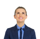 Smiling business woman looking up on copy space Stock Images